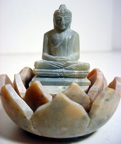 stone buddha carving statue in rock statuette of Budda