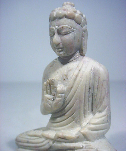 stone buddha carving statue of Buddha in protection gesture