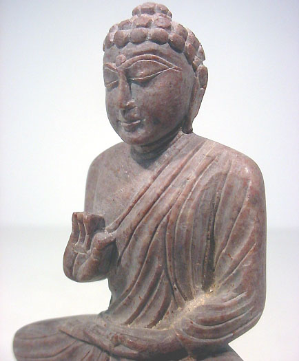 Buddha handcarved from marble stone into buddha statue gesture of protection