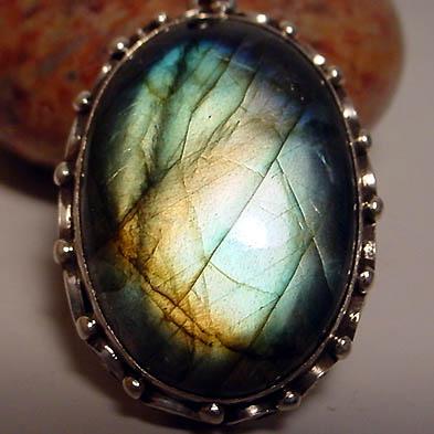 92.5 silver jewelry earrings and pendants with rainbow moonstones, labradorite, garnet, amethyst, turquoise, lapis, tigers eye, black star, moonstone, onyx, malachite, peridot, tourmalinated quartz, amber, and more...